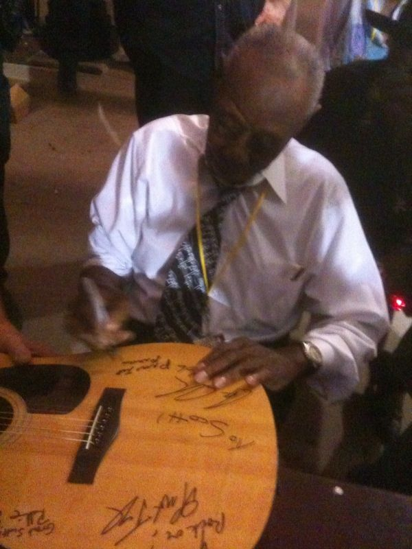 Pinetop Perkins signs my guitar (2nd autograph) after a performance at the Urbana Sweetcorn Festival, Urbana, IL - August, 2008