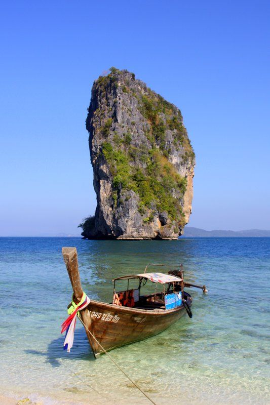 Longtail boat on Phra Nang Beach overlooking Ko Tapu (Nail Island) aka James Bond Island - Krabi, Thailand.