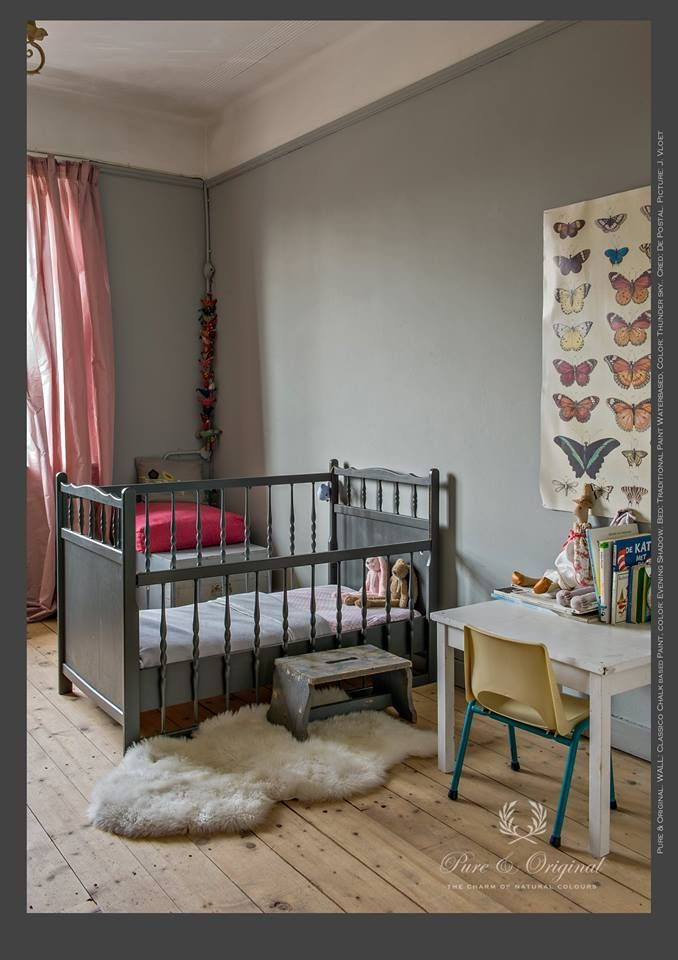 Walls painted in Pure and Original Classico chalk paint in the colour, 'Evening Shadow'. Cotbed it painted in Pure & Original Traditional Waterbased Paint in the colour 'Thunder Sky'  Children's nursery in grey. #babyroom #nursery #kidsroom #kidsinterior #interiodesign #cot #greykidsroom #butterflyprint #greycrib #crib #greyandpink #rustic #pureandoriginal #safepaint #naturalpaint #paintforkidsroom #vocfree #nontoxic #designstudiov #chalkpaint
