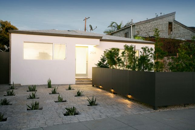 Instead of spending more money to cut up the original cement and haul it away, Sweet punched holes in the ground and added plants that will soon grow to four or five feet tall, creating an outdoor sculpture of sorts.     Read more: http://www.dwell.com/slideshows/Living-in-Marina-del-Rey.html?slide=6=y=true##ixzz25iAa85Y6
