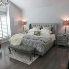 Pink Tinted Lamp Light Decorated The Gray Wall Color Over Tufted Gray Headboard and Bench Surrounding Neutral Bed Linens
