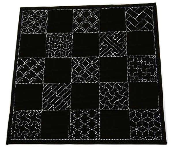 Sashiko is often referred to as Japanese embroidery. Literally, it means 'little stab'. The beauty of sashiko is in its simplicity. Sashiko is worked with a straight stitch or running stitch. Each sam