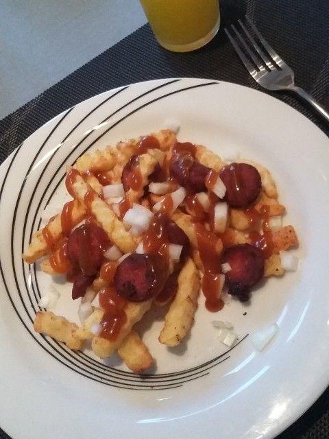 Hjemmelavet pølsemix - mix of sausage and pommes frites. Fastfood at home.