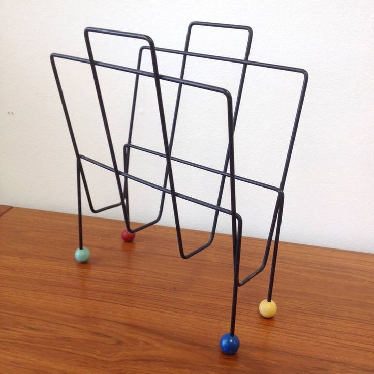 Midcentury Iron Record Holder with Colorful Ball Feet at 1stdibs