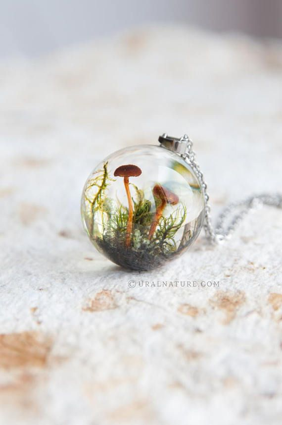 This whimsical sphere necklace features composition of fungus, lichen and moss from the local forests. Little piece of wild nature captured in the crystal resin. Its truly unique necklace with fascinating 3d effect, as unique as nature itself. Not a glass, made of non-toxic clear resin, lightweight and non-breakable. High quality, no bubbles, glossy surface. Pendant size: orb is 25 mm (1) in diameter Stainless steel chain length: approx. 70 cm (28) This necklace arrives in the natural…