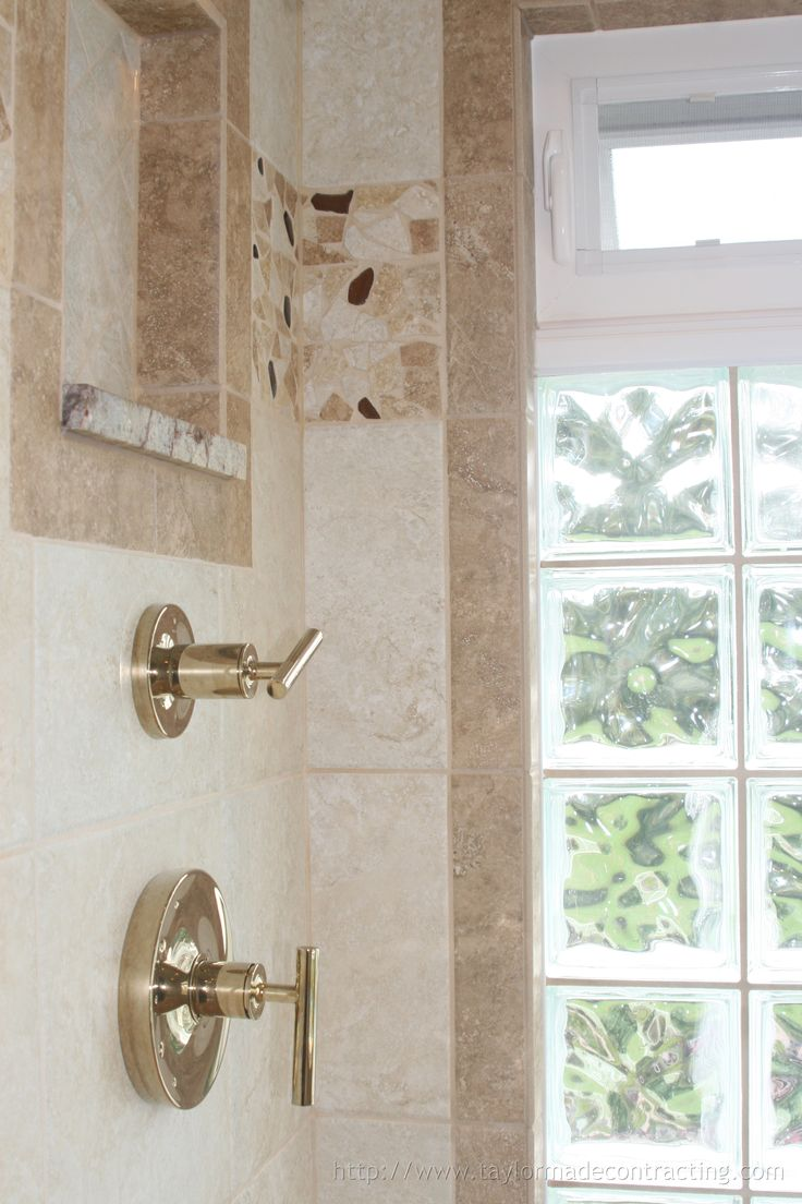 These shower windows allow for light to enter the room - saving energy -  without invading