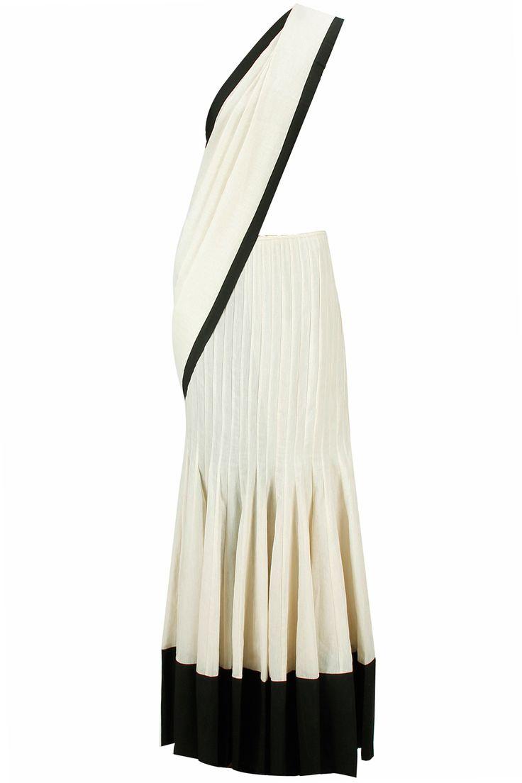 Stone triangle print blouse with stone drape lehenga sari available only at Pernia's Pop-Up Shop. a stone silk mul lehenga sari with attached draped pallu . It comes along with stone colour triangle print choli and black semi crepe petticoat.