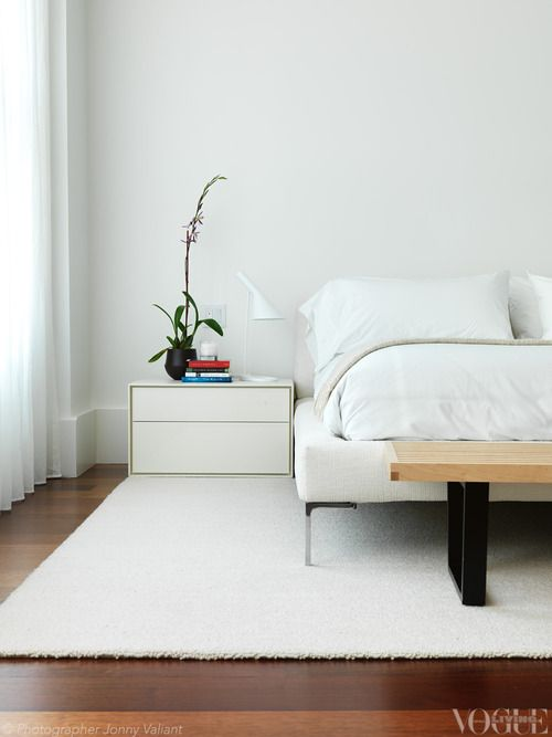This cool, white bedroom by Melbourne's Nexus Designs features a B&B Italia 'Charles' bed upholstered in 'Soraia...