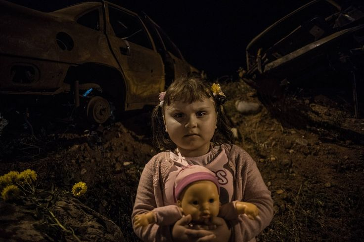 FIVE YEARS LATER: A girl held a doll and posed for a picture in Tskhinvali, South Ossetia, Thursday. Georgia is marking the 2008 war with Russia over Georgia's disputed separatist territory of South Ossetia. In the wake of the war, Russia acknowledged South Ossetia's independence. (Sergei Karpov/ITAR-TASS/Zuma Press)