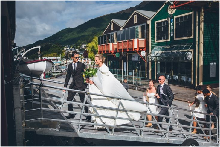 The bride and groom board the TSS Earnslaw for their cruise out to Walter Peak High Country Farm  #WalterPeak #NZweddings #Queenstown #RealJourneys #TSSEarnslaw #LakeWakatipu #NewZealand