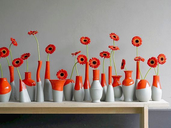 """A collection of unique vases painted white then """"dipped"""" in a second color on a shelf/mantle is a great idea!! (link is really about: Ten tips on how the UEFA Euro 2012 can be fun for women)"""