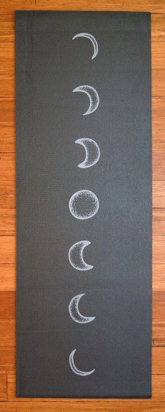 I like this Moon Cycle Black Printed Yoga Mat - Lunar Flow Luminous Night Sky Astronomy Screen Printed Hand Drawn