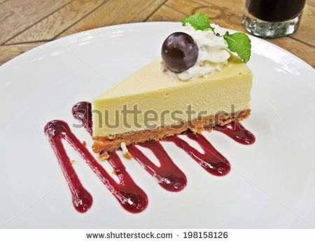 grape cheese cake with sweet grape sauce on white plate by lazybuffy, via Shutterstock