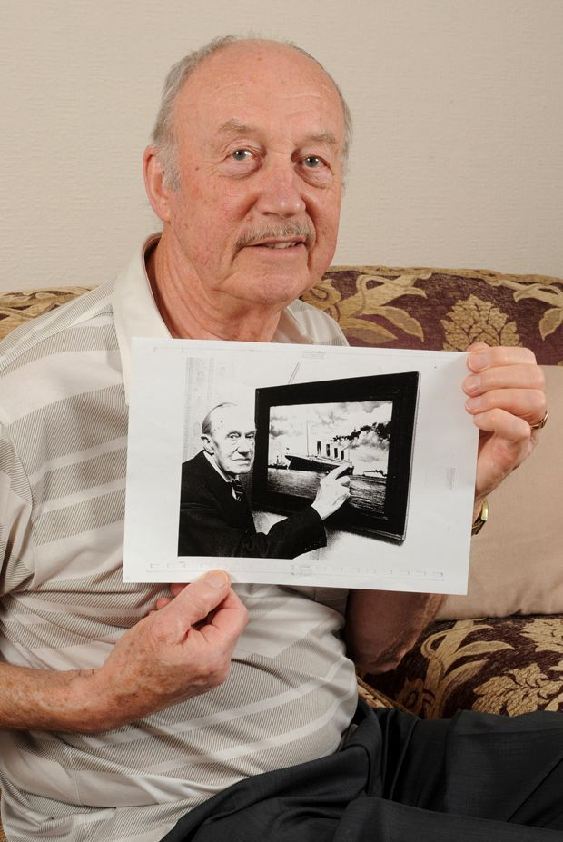 """So proud: Son Richard holds a photograph of his father. Sidney was picked to be a Titanic steward after impressing bosses on its sister ship RMS Olympic. Richard said: """"Dad's steward's uniform was impeccable. He had to make sure the rooms were spotless and the passengers well cared for. """"He looked after Ida Strauss, who refused to board a lifeboat without husband Isidor. The couple died together on the ship."""" A night watchman woke Sidney on the fateful night and sent him to the lifesta"""