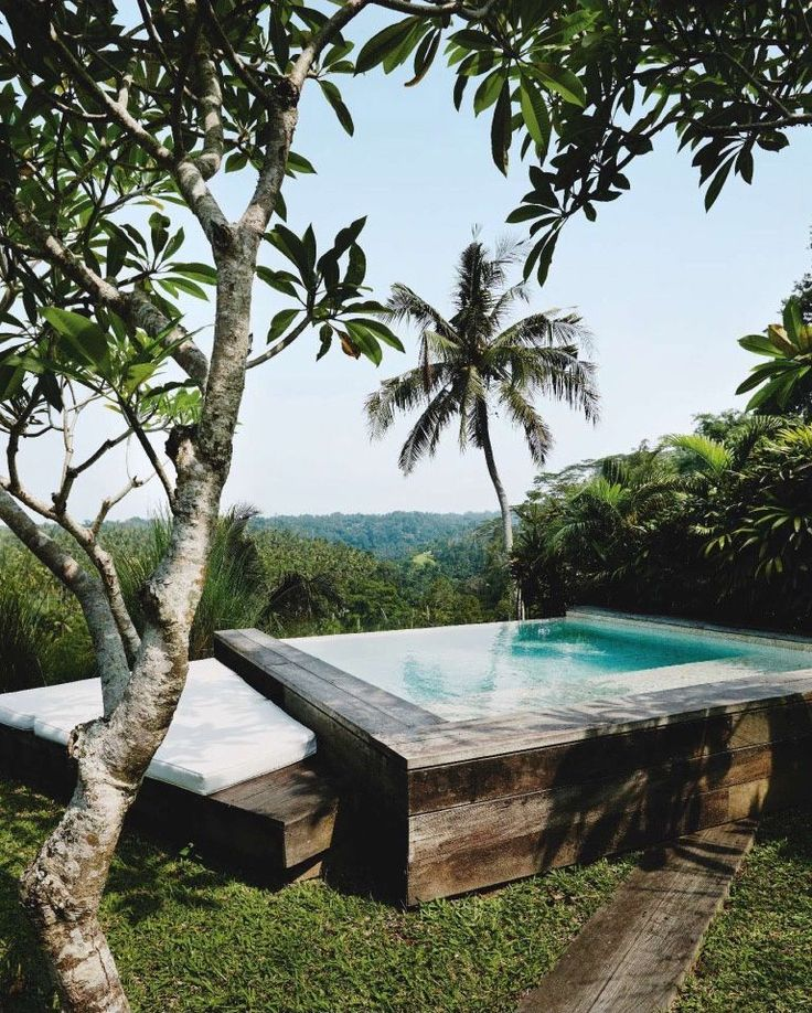 """thedesigncollector: """" Tropical mood: in Bali, the garden of a stunning house, immersed in the forest, facing the sea. See the interior on MadAbout -Interior-Design """""""