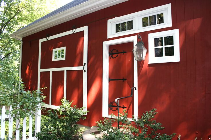 Beautiful red household doors   ... summer. I love how the out-building mimics the windows of the home