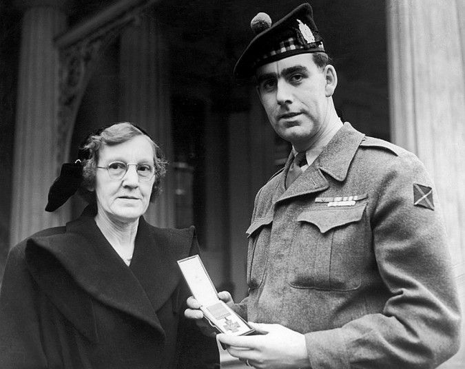 1952, Private William Speakman of The King's Own Scottish Borderers is awarded the VC for action in the Korean War during the first Investiture by  Her MajestyThe Queen.