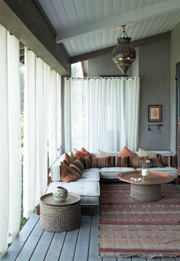 curtained outdoor living space with Moroccan feel
