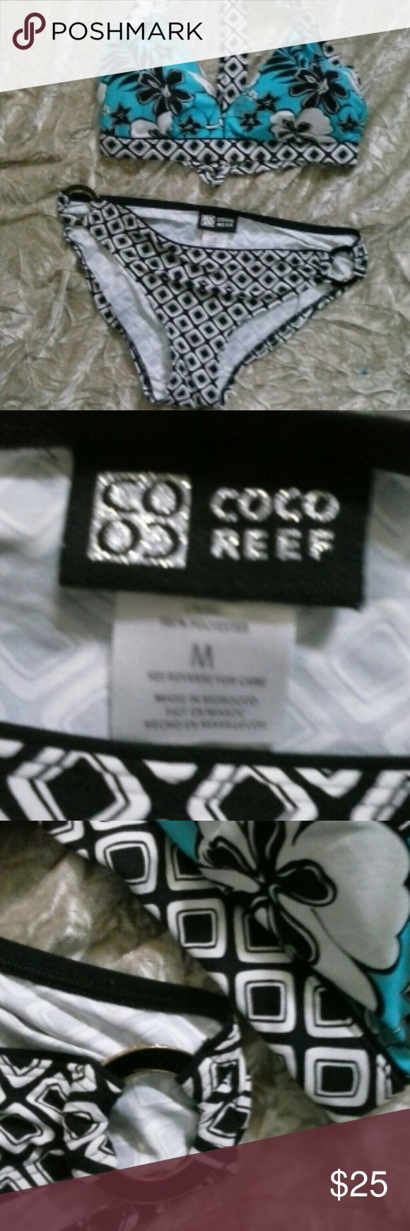 """LN Coco Reef Bikini  w/Reversable Halter Top M Like New Coco Reef bikini with reversible halter, tie back top one side black and white geometric to match bottom, other side of top turquoise white and Black tropical floral pattern with matching geometric. Bottoms have beautiful black enamel and gold tone metal. Bottom across measures 15"""" flatlay, side see thru ring 2"""" high approx, top from end of cup to cup 15"""", center 6"""". tie back from end to end approx 48"""" Feel free to ask questions. Thanks…"""