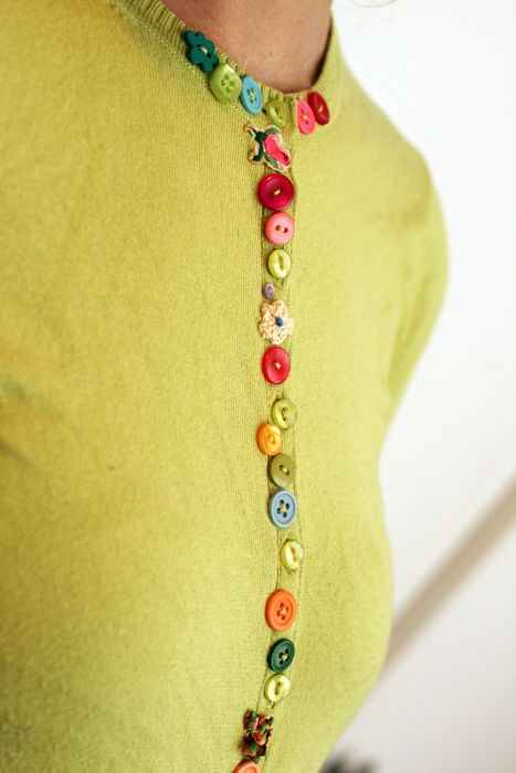 Sew buttons in a row on a sweater
