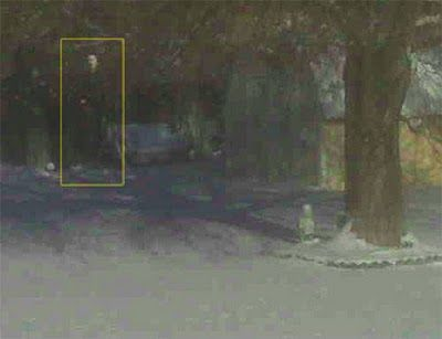 """""""Taken in my backyard 12-06-09,"""" says Patrick. """"In the upper left-hand corner there seems to be a person who wasn't there. Zooming in on the face just makes it weirder.""""  - from Patrick S. Heil"""