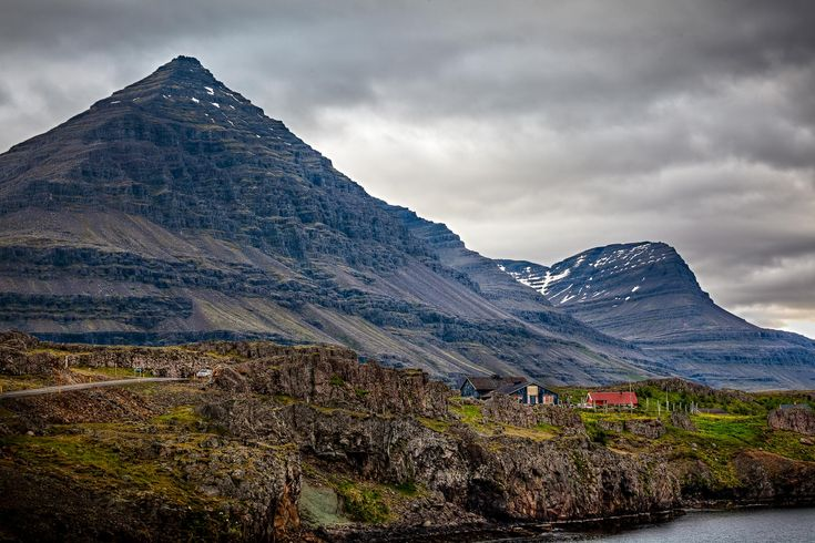 A tiny hamlet, set against stunning mountain scenery, by the coast in Northern Iceland.