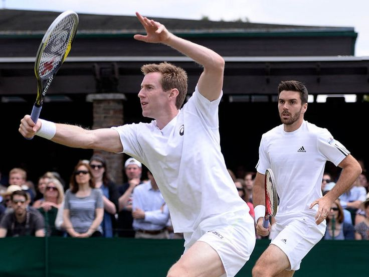 Briton Jonny Marray (l) continued his doubles title defence alongside Colin Fleming on Day 7 of Wimbledon 2013.
