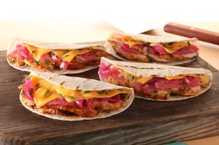 Grilled Chicken Quesadillas recipe -Cheese slices and red onions give these Grilled Chicken Quesadillas a nice flash of color—and the cilantro and BBQ sauce provide great flavo