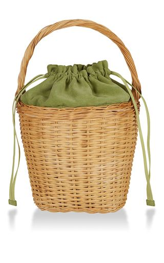 This **Edie Parker** Lily tote is rendered in straw and features a playful basket silhouette and suede lining.