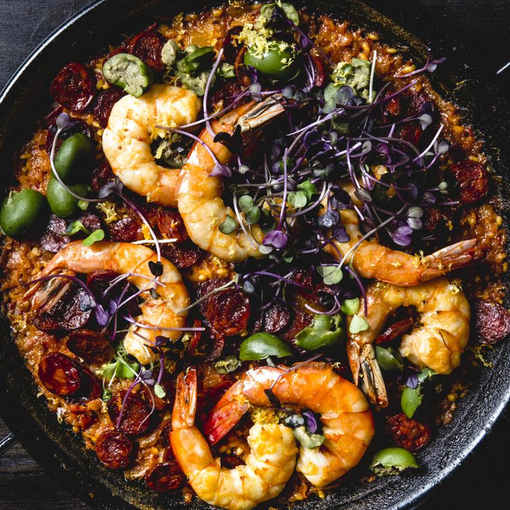 Bomba rice is a short-grain, starchy type, and its ideal texture is tender but chewy in the center, like al dente pasta. Try not to overcook. Use the shrimp shells and chorizo ends to make the Back-Burner Stock.