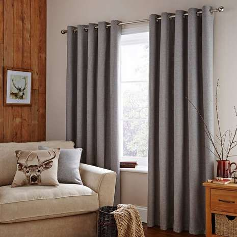Featuring a classic woolen look woven texture in a grey tone and an eyelet header for a smooth motion, these thermal lined ready made curtains are available in ...