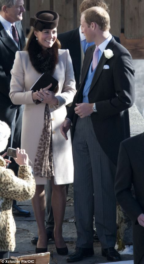 The Duchess of Cambridge, seen exchanging a smile with husband William, left, and chatting with the vicar, right, wore a cream coat over a patterned dress. March 2, 2013