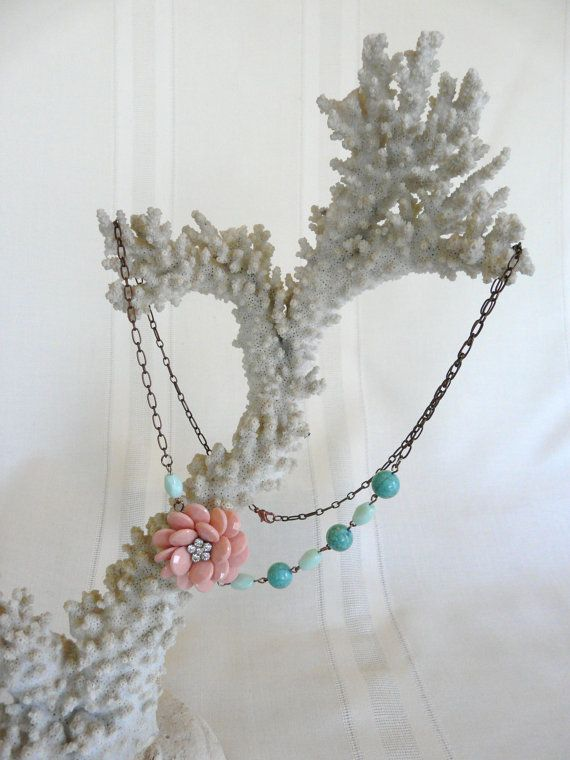 Antiqued gold chain with peach flower accompanied by PlaneNSimple