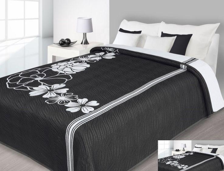 Narzuty dwustronne na łóżko w czarnym kolorze w białe kwiaty