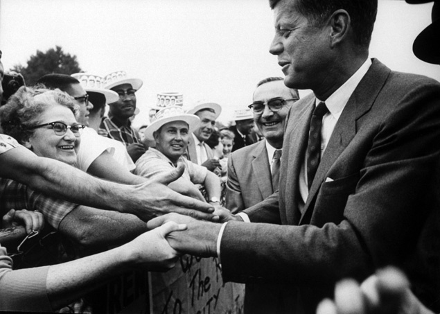 Resultado de imagem para Senator John F Kennedy shaking hands during his presidential campaign. Photo by Paul Schutzer/The LIFE Picture Collection/Getty
