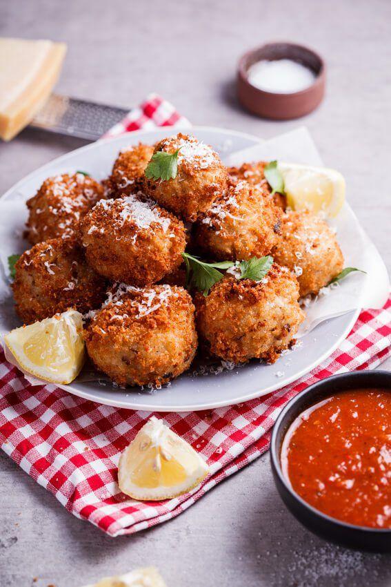 Mushroom arancini stuffed with mozzarella served with roasted tomato sauce…