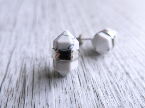These delicate earrings are made from double terminated howlite stones. The stones are banded in silver and finished with silver post studs for