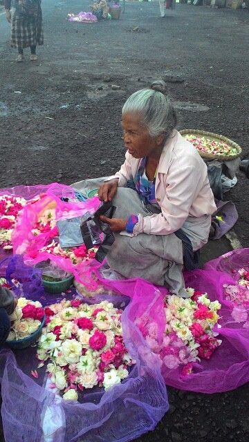 An old woman, flower seller.. The other side of Salatiga. #Indonesia #salatiga