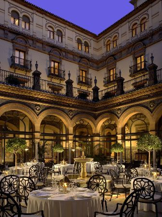 Tea at the Alfonso XIII Hotel, Seville. Named for the king who commissioned it in 1928 it is one of the most prestigious hotels in Europe.