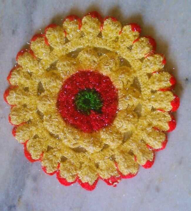 This coaster is made of wool..radius of this coaster is 6 inches.. Beautiful color combination of yellow,red and green is used.
