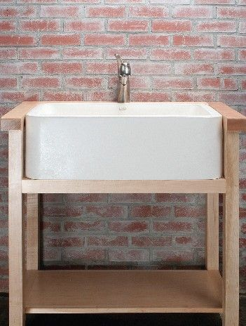 the sink stands alone on an open shelf unit. this is an option... but with darker, more rustic wood.