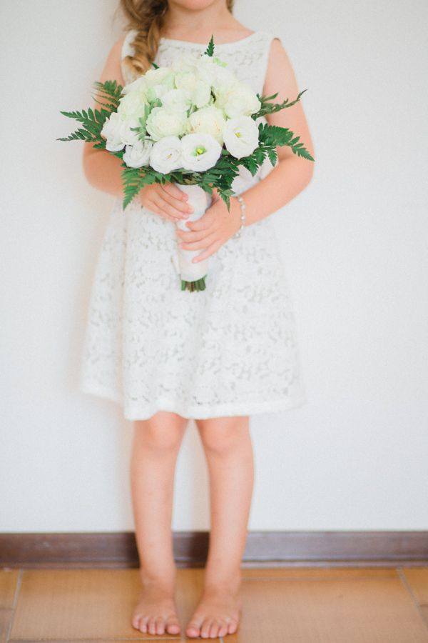 Cute flower girl with bouquet