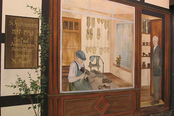 Wandmalerei an einem Fachwerkhaus in der Innenstadt von Wernigerode.