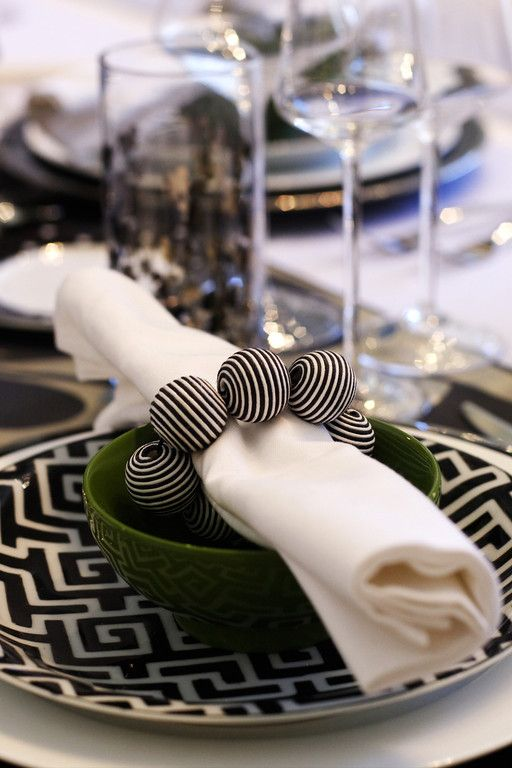 black and white napkin ring balls <3 and I have used bracelets like this for napkin rings too :)