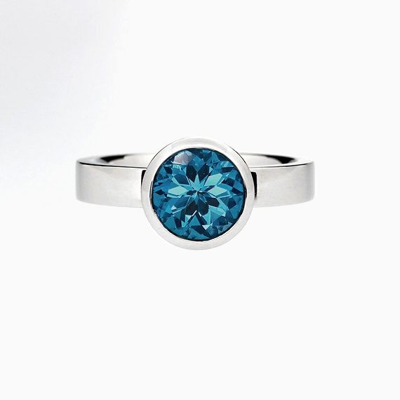 Bezel engagement ring with London Blue Topaz in Palladium