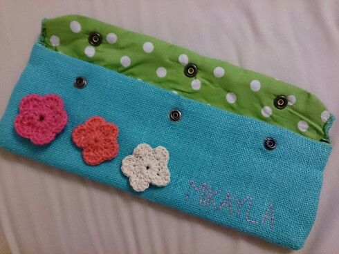 Pencil bag with crochet flowers