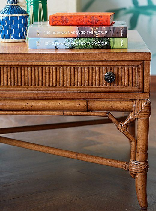 Fine details—pewter-finish drawer pulls, wrapped joints—give this maple-and-rattan coffee table an earthy elegance.