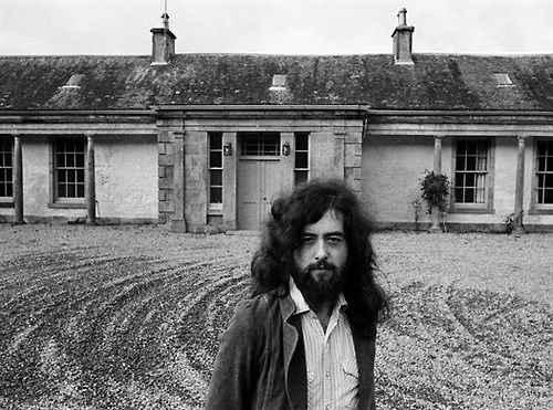 Jimmy Page in front of Boleskine House, the estate of Aleister Crowley from 1899 to 1913. Boleskine House is located on the South-Eastern shore of Loch Ness in Scotland,