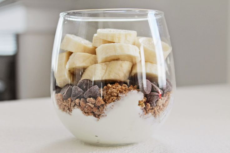 Yogurt, granola, dark chocolate chips, top it off with bananas and lemon juice!