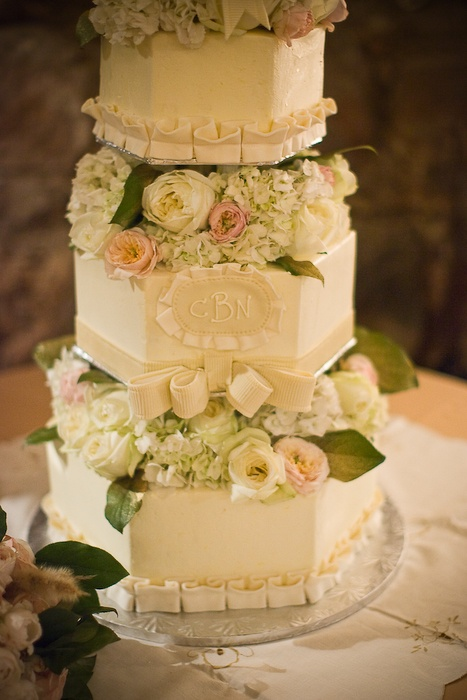 I like the hexagonal shape of this cake and it has the flowers between the layers like the other one you liked